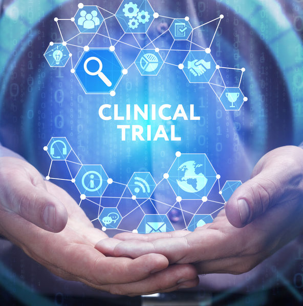 Business, Technology, Internet and network concept. Young businessman shows the word on the virtual display of the future: Clinical trial